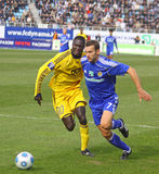 Andriy Shevchenko and Papa Gueye stock images