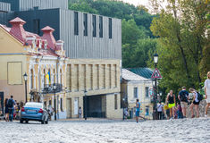 Andriyivskyy Descent, pedestrian street Ukraine, Kyiv, Podil. Ed. People are walking on the Andriyivskyy Descent near new building of the Podol Theater in the Royalty Free Stock Image