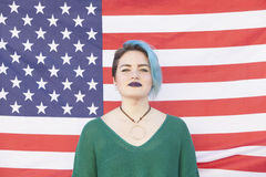 Androgynous lesbian woman isolated on a United States of America. Androgynous lesbian woman fighting for equality of gender isolated on a United States of Royalty Free Stock Photos
