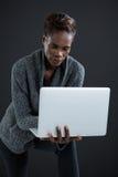 Androgynous mężczyzna używa laptop Obraz Royalty Free