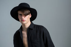 Androgynous man in hat posing Stock Photo