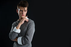 Androgynous man posing with hand on chin Royalty Free Stock Image