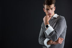 Androgynous man posing with hand on chin Stock Photos