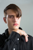 Androgynous man posing with hand on chin Royalty Free Stock Photo
