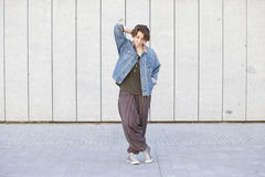Androgynous teen woman wearing trendy jean clothes Royalty Free Stock Photography