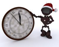 Android with clock before midnight Stock Photo