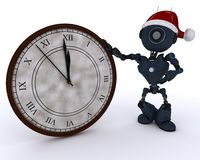 Android with clock before midnight Royalty Free Stock Image