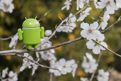 Android figurine on almond tree. ESTOI, PORTUGAL - FEBRUARY 4, 2018 - Android figurine on top of branch of a  almond tree on the countryside, located on the Stock Photography