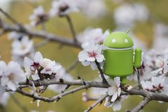 Android figurine on almond tree. ESTOI, PORTUGAL - FEBRUARY 4, 2018 - Android figurine on top of branch of a  almond tree on the countryside, located on the Royalty Free Stock Photo