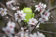 Android figurine on almond tree. ESTOI, PORTUGAL - FEBRUARY 4, 2018 - Android figurine on top of branch of a  almond tree on the countryside, located on the Royalty Free Stock Photography