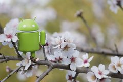 Android figurine on almond tree. ESTOI, PORTUGAL - FEBRUARY 4, 2018 - Android figurine on top of branch of a  almond tree on the countryside, located on the Stock Photos