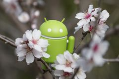 Android figurine on almond tree. ESTOI, PORTUGAL - FEBRUARY 4, 2018 - Android figurine on top of branch of a  almond tree on the countryside, located on the Royalty Free Stock Image