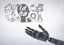 Android hand with idea and business graphic drawings. Digital composite of Android hand with idea and business graphic drawings Royalty Free Stock Photo