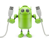 Android holding USB cables Royalty Free Stock Photography