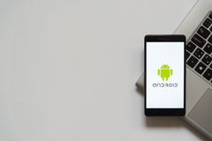 Android logo on smartphone screen. Bratislava, Slovakia, April 28, 2017: Android logo on smartphone screen placed on laptop keyboard. Empty place to write royalty free stock photography