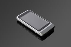 An Android mobile phone. On a black glass table Stock Photo