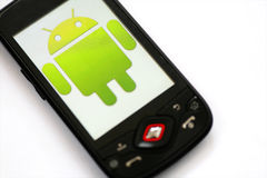 Android phone. Close-up shot of an Android smartphone with the Android logo displayed on the screen. Android is a software stack for mobile devices that includes royalty free stock photography