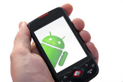 Android phone. Bucharest, Romania - June 21, 2011: Close-up shot of a hand holding an Android smart-phone with the Android logo displayed on the screen. Android royalty free stock photos
