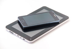 Android phone and android tablet on the white background.  royalty free stock photos