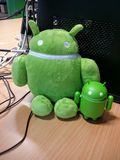 Android plush and plastic figures. On a table in an office Royalty Free Stock Images