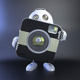 Android Robot with compact digital camera Royalty Free Stock Photos