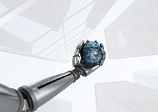 Android Robot hand holding planet earth with skyscraper bright background Stock Photography