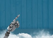 Android Robot hand pointing with blue background Stock Photo