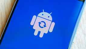 Android robot logo icon on the Samsung smart phone screen during update