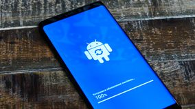 Android Robot Logo Icon On The Smart Phone Screen