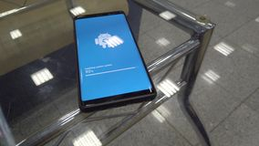 Android Robot Logo Icon On The Smart Phone Screen During Update Installation