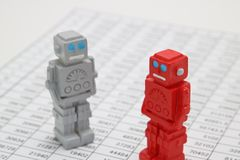 Android robots or artificial intelligence and numbers are written documents on white background. Android robots or artificial intelligence and numbers are Royalty Free Stock Photo