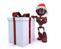 Android in a Santa hat with Christms Gift Royalty Free Stock Image