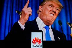 An android-smartphone that shows the Huawei logo in front of the picture of Donald Trump. PERAK, MALAYSIA - MAY 24, 2019: An android-smartphone that shows the stock images