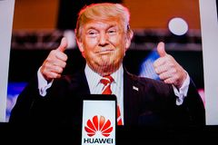 An android-smartphone that shows the Huawei logo in front of the picture of Donald Trump. PERAK, MALAYSIA - MAY 24, 2019: An android-smartphone that shows the royalty free stock image