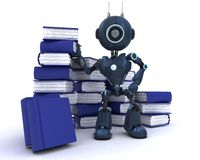 Android at with stack of books Royalty Free Stock Photos