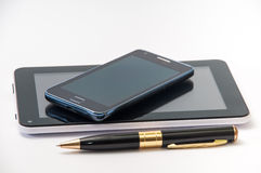 Android tablet, mobile phone and black pen Stock Photography
