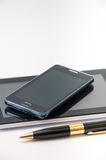 Android tablet, mobile phone and black pen.  stock photo