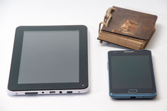 Android tablet and phone and old antique paper notebook.  royalty free stock photo