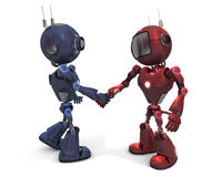 Androids shaking hands Stock Photo