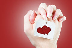Нands of loving couple with heart  close-up Stock Images