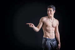 Andsome shirtless young man laughing and pointing Royalty Free Stock Images