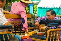 ANDUJAR,SPAIN - September, 6: Participants at the Horse Fair eat Royalty Free Stock Image