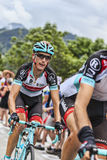 Andy Schleck Climbing Alpe D'Huez. Alpe-D'Huez,France- July 18, 2013: The Luxembourgish cyclist Andy Schleck  from Radioshack Leopard Team climbing the difficult Royalty Free Stock Photos