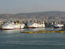 Anek Lines and Hellenic Seaways. PIRAEUS, GREECE - JULY 01, 2006: Anek Lines Lissos and Kriti I ferry boats together with Hellenic Seaways Express Athina docked royalty free stock image