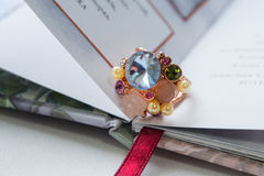 anel com as pedras no livro Imagem de Stock Royalty Free