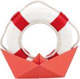 Anel de vida em um barco feito fora do papel Imagem de Stock