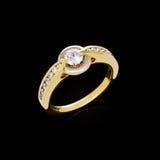 Anel dourado com diamantes Imagens de Stock Royalty Free
