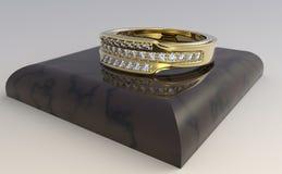 Anel dourado com diamantes Imagem de Stock
