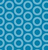 Anelli bianchi su backgroung blu. Fotografia Stock Libera da Diritti