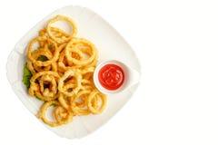 Anelli del calamaro in pastella su un bianco Immagini Stock